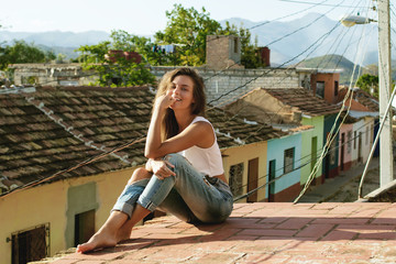 Woman sitting on the roof
