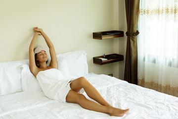 Woman is relaxing in bedroom