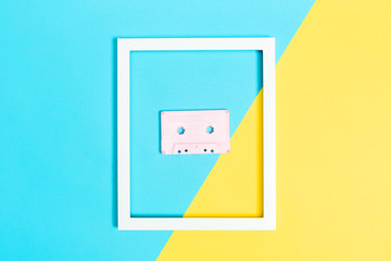 Cassette tape and frame on split background