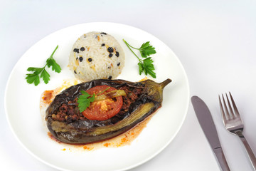 Turkish cuisine. Karniyarik and rice pilaf with black corinth raisin. Eggplant stuffed ground meat.
