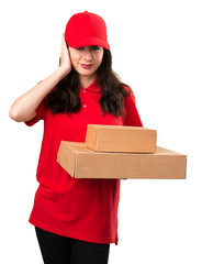 Delivery woman covering her ears