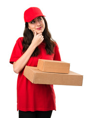 Young delivery woman thinking