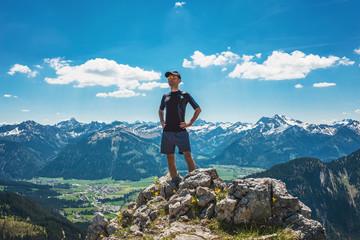 Confident hiker on mountain summit