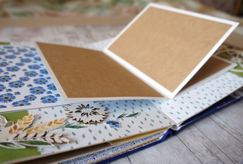 Scrapbooking, details of photoalbum with cornflowers