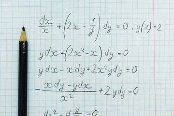 Mathematical examples in the notebook, calculations.