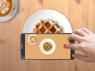 Taking photo of waffle with smartphone.