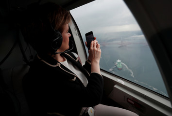 Nicola Sturgeon, First Minister of Scotland, looks out of the window of a helicopter as she crosses the Firth of Forth during a campaign trip in Scotland