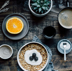Breakfast of granola, fruit and coffee, overhead view