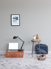modern holiday concept different baggage style and grey wall decoration