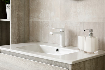 modern and clean toilet, sink and toiletries