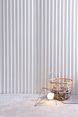 white decorative panel background basket and lamp concept