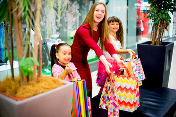 Mother and daughters shopping