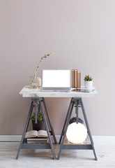 working decoration marble table and grey foots lamp and vase of flowers