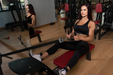 Healthy Young Woman Doing Exercise For Back