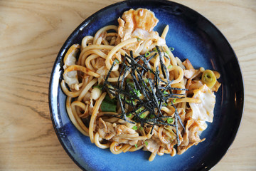 Yakisoba pork on wood , Japanese food