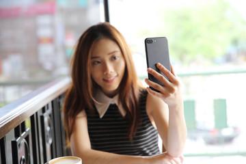 Asian young woman selfie
