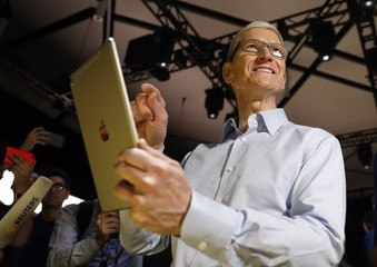 Tim Cook, CEO, holds an iPad Pro after his keynote address to Apple's annual world wide developer conference (WWDC) in San Jose