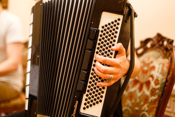Accordion player The musician playing the accordion player instrument