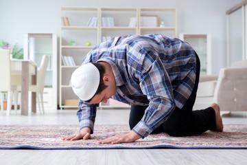 Muslim man praying at home