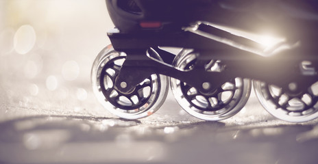 Road and wheels of roller skates closeup
