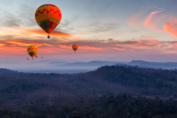 Colorful hot air balloons flying over mountain at Pakse, Laos