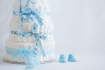 Diaper Cake and baby boy shoes for a baby shower.