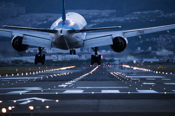 In the evening, the plane is about to land on the runway