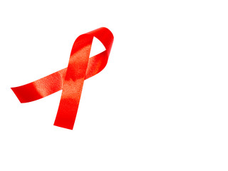 World AIDS day concept. red ribbon on white paper