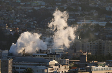 Smoke rises from smokestacks of a food factory in Valparaiso, Chile