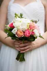 Tender wedding bouquet in Bride's hands in wedding day