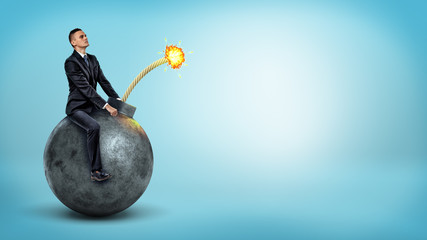 A small businessman riding a big round bomb with a lit fuse on blue background.