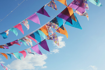 Summer festive colorful bunting and blue sky, summer event celebration