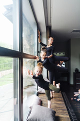 Mom and two daughters practice ballet