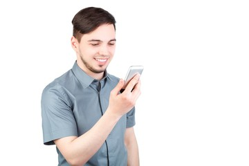 young man answering smartphone over white background. A man is talking on the phone