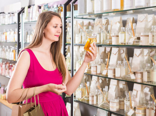 woman take a choise fresh perfume in perfume supermarket