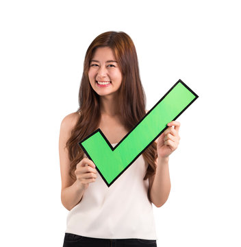 Asian woman holding check mark on isolated background.
