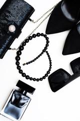 Stylish woman accessories, handbag clutch, black shoes, trendy sunglasses and perfume