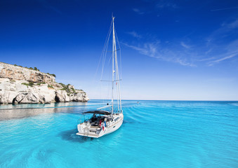 Beautiful bay with sailing boats yacht, Menorca island, Spain. Yachting, travel and active lifestyle concept