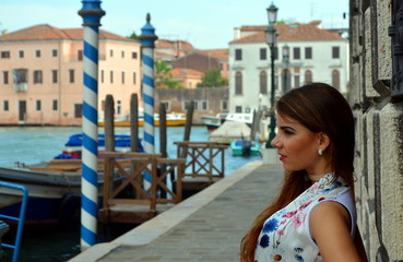 Young girl with blue skirt and flower shirt in Venice