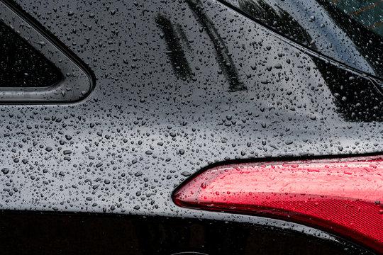 aile arrière voiture carrosserie pluie goutte eau perle noir blanc design feu