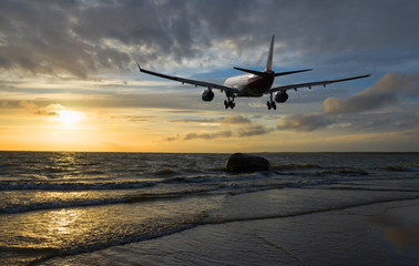 Airplane flying over the sea.