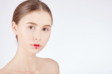 Woman with a natural beauty makeup look over a white background