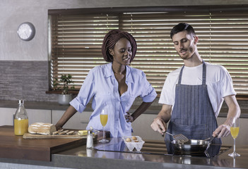 breakfast preparation  kitchen cooking mixed race couple