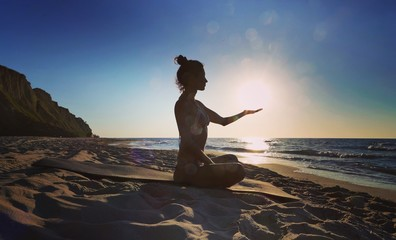 morning meditation on the sea coast