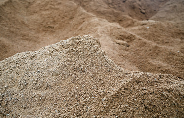 Closeup of sand. Coarse sand grains background. Selective focus.