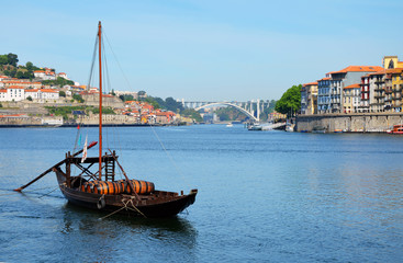 Porto, Portugal - 2nd May, 2017: Rabelo (traditional portuguese cargo boat) on Rio Douro and Ribeira (old town), a Unesco World Heritage