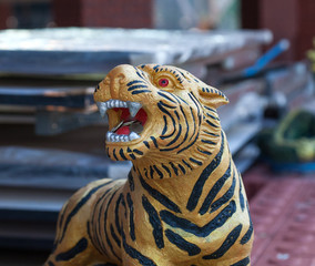 Sculpture of a Tiger with coins in the mouth - the symbol of the Tiger temple, Kanchanaburi, Thailand