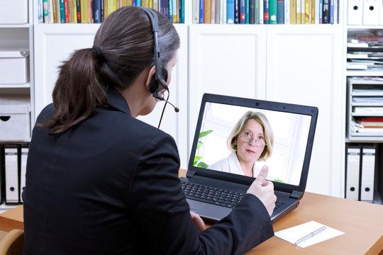 Female accountant headset online meeting