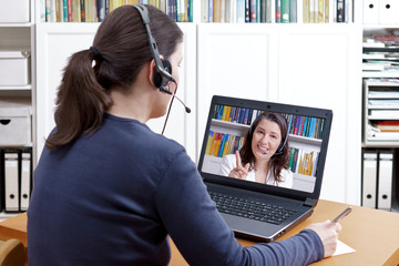 woman headset video call tutor