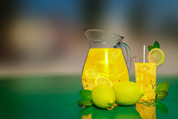 3d rendering of lemonade with ice and mint in a jar and a glass on a green table with bokeh background.